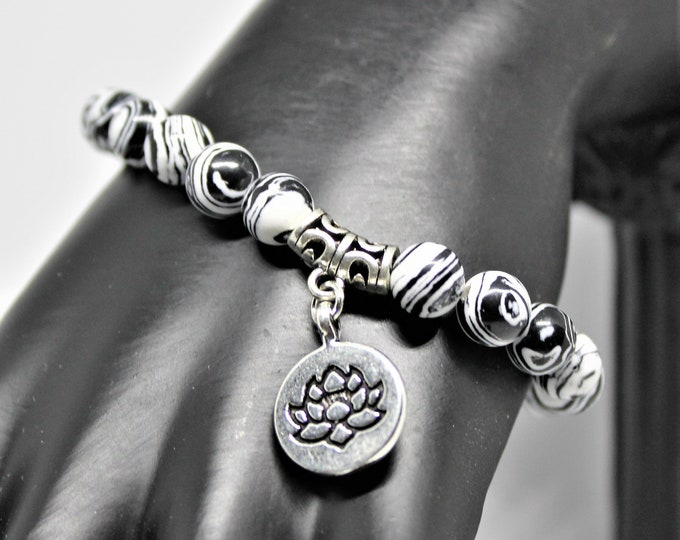 Black and white stacking bracelet, lotus charm bracelet, elegant beaded bracelet, unique layering bracelet, everyday accessory for her