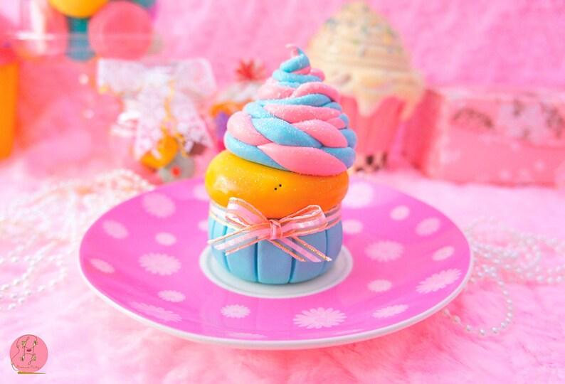 Lavinia fenton giant Cupcake with swirl melted ice cream on image 0