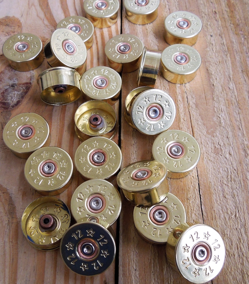 Brass plated/stars 12 gauge shotgun shell head stamps (25 size lot)