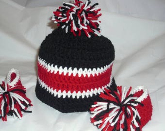 3df9c3f89dd Black and red newborn hat and booties set. Atlanta Falcons   themed hat and  booties set. Pom-pom hat and booties.