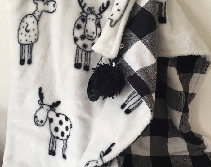 large black and white buffalo plaid and moose pom pom flannel blanket