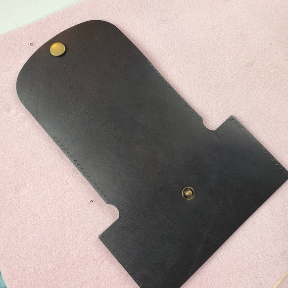 Leather blank with snap and sewing holes
