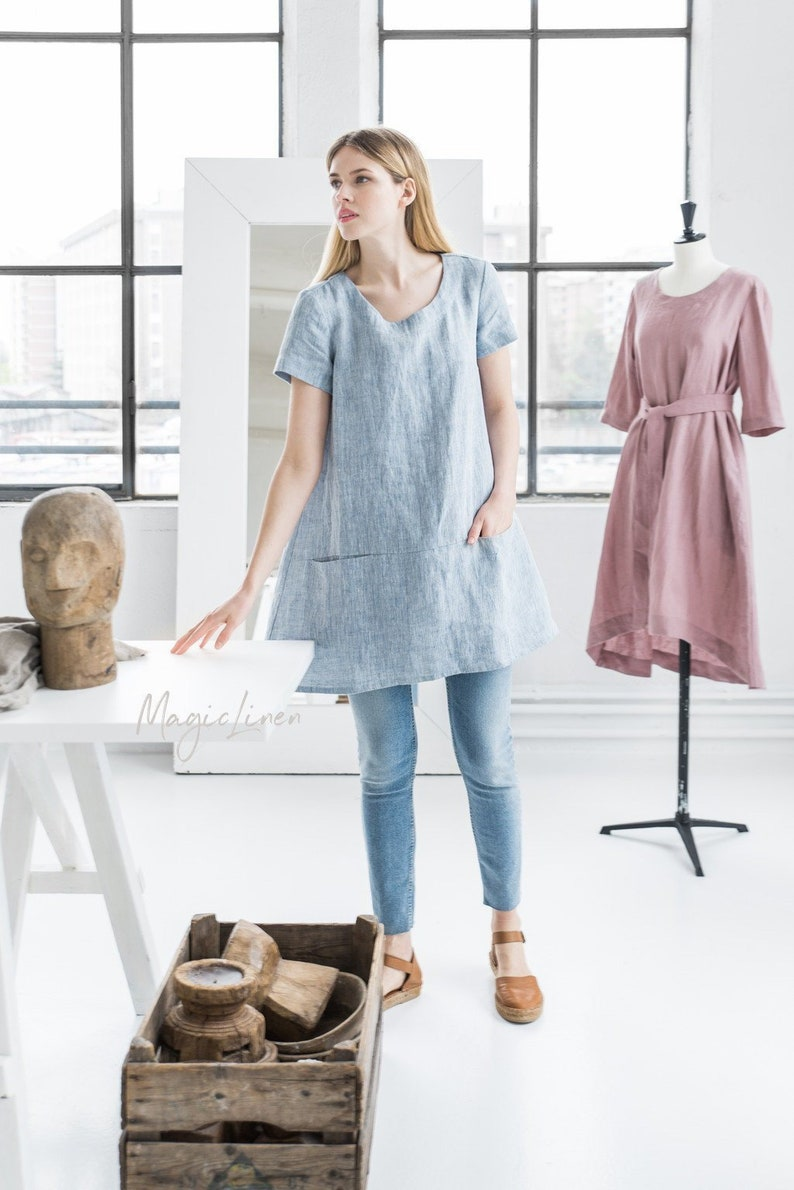 This chambray blue linen artist style tunic with front pockets is perfect for running errands!