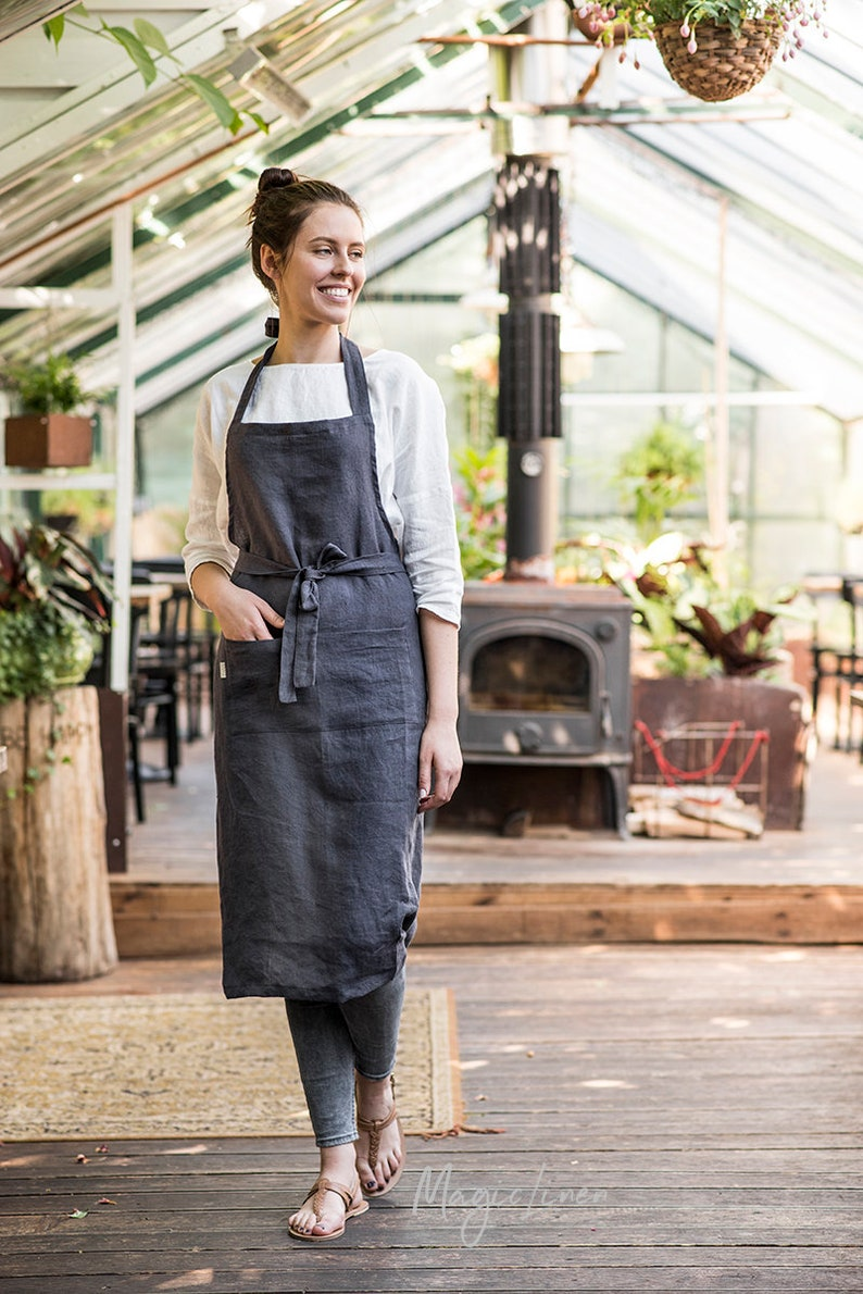 Charcoal gray linen apron. Washed full apron with front pockets. Come discover lovely European Country Bespoke Linen for Home & You! #europeancountry #interiordesign #linen #handmadelinens #linenclothing #linendecor #homedecor