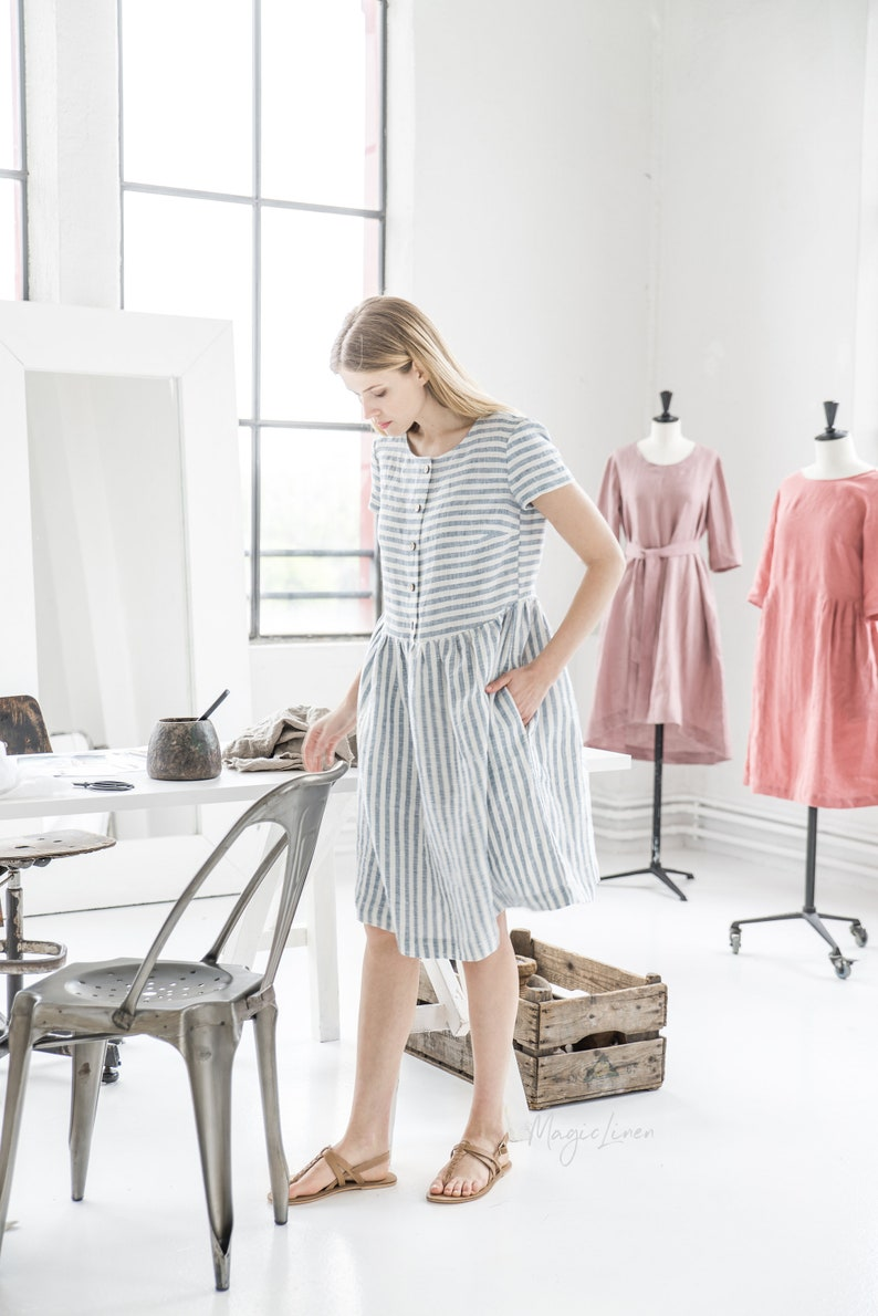 Come discover these Over 50 Fashion: Running Errands Comfy Cute Pieces! Blue and white striped linen dress with pockets is so comfortable and perfect for layering. #fashionover50