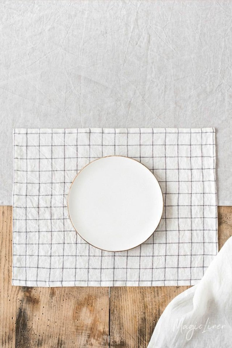 Grey and white linen placemat.
