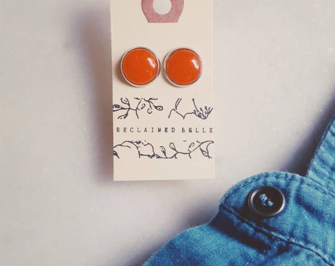 Red crystal pebble studs on stainless surgical steel