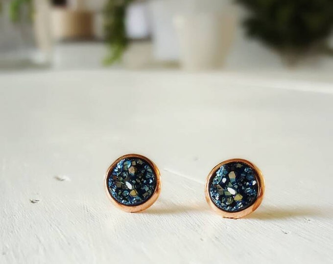 8mm small navy druzy studs on rose gold posts.