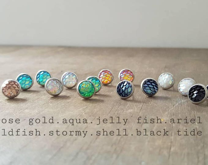 Tiny 8mm mermaid studs on stainless surgical steel