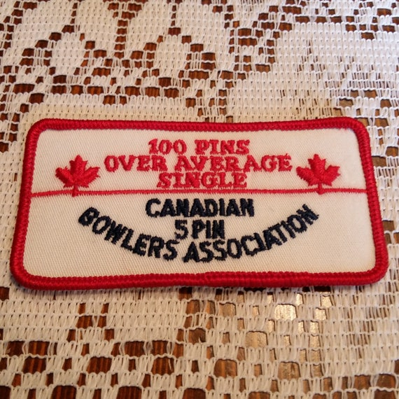 100 Pins Over Average Canadian Spin Bowlers Patch Applique Crest Logo 4 inches x 2 inches