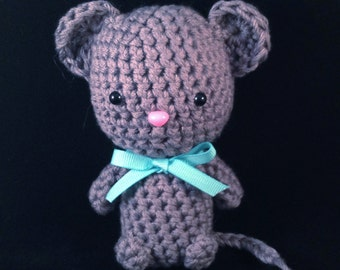 Meet Francis: the tiny handmade housemouse with heart. Crocheted to custom specs. Wearing a colored ribbon for awareness.