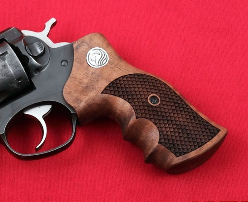 RUGER GP100 grips made from Walnut wood with Ruger logo made of pure  silver  (make your own custom pair of grips)