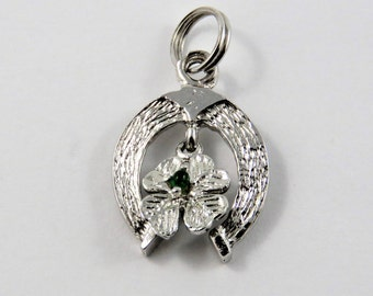 Double Good Luck Charms Four-Leaf Clover Hanging From a Horseshoe Sterling Silver Charm or Pendant.