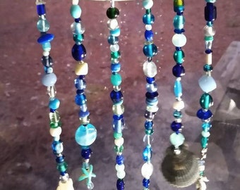 Ocean Driftwood, Ocean blue glass suncatcher. Ocean Shells collected. Beach decor, patio accent, window