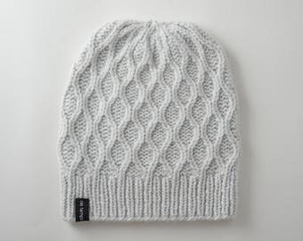Hand knitted white scarf and hat