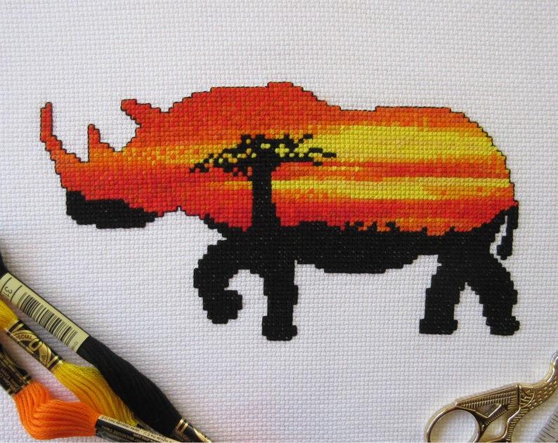 Rhinoceros cross stitch pattern PDF sunset rhino counted image 0