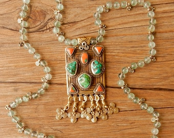 Necklace of fluorite stones with magnificent handmade Tibetan pendant (brass, turquoise stones, coral) with Buddhist symbol