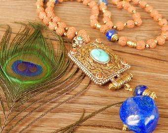 Ethnic necklace with Tibetan pendant, rudra grains and lapis lazuli