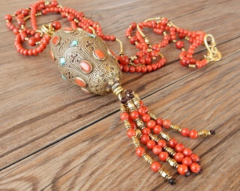 Ethnic necklace with large Tibetan artisan pearl and coral and brass pearl threads