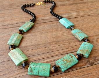 Ethnic choke necklace with large turquoise stones and black onyx