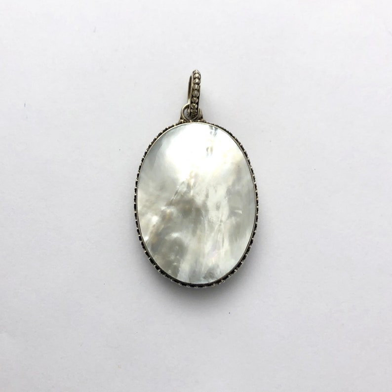 Oval mother of Pearl sterling silver pendant