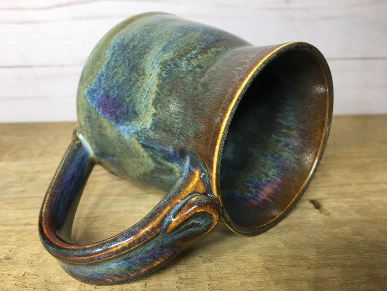 Single multicoloured handmade mug with thumb rest