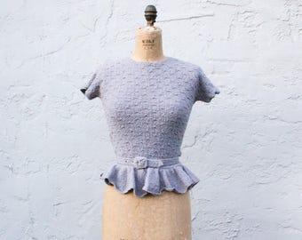 Vintage 1950s boucle peplum sweater