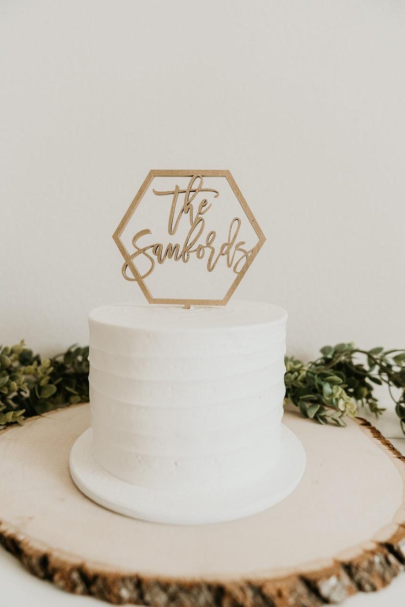custom last name cake topper custom cake topper wedding cake image 0