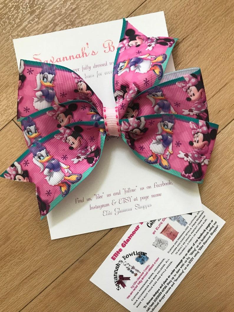 6726f7354 Minnie mouse and daisy duck hair bow minnie and daisy hair
