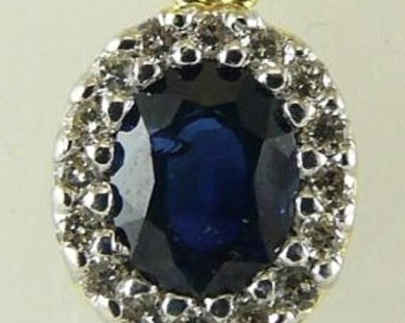 Sapphire 0.48ct Pendant 14k Yellow Gold and Diamonds 0.10ct