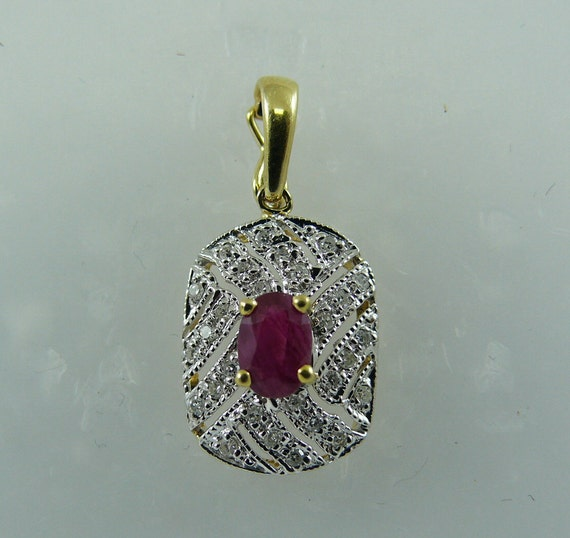 Ruby 0.63ct Pendant 14k Yellow Gold and Diamonds 0.15ct
