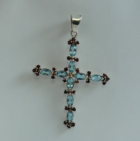 Blue Topaz and Garnet Cross Pendant with Sterling Silver