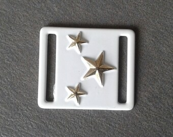 Accessory white metal and gold stars