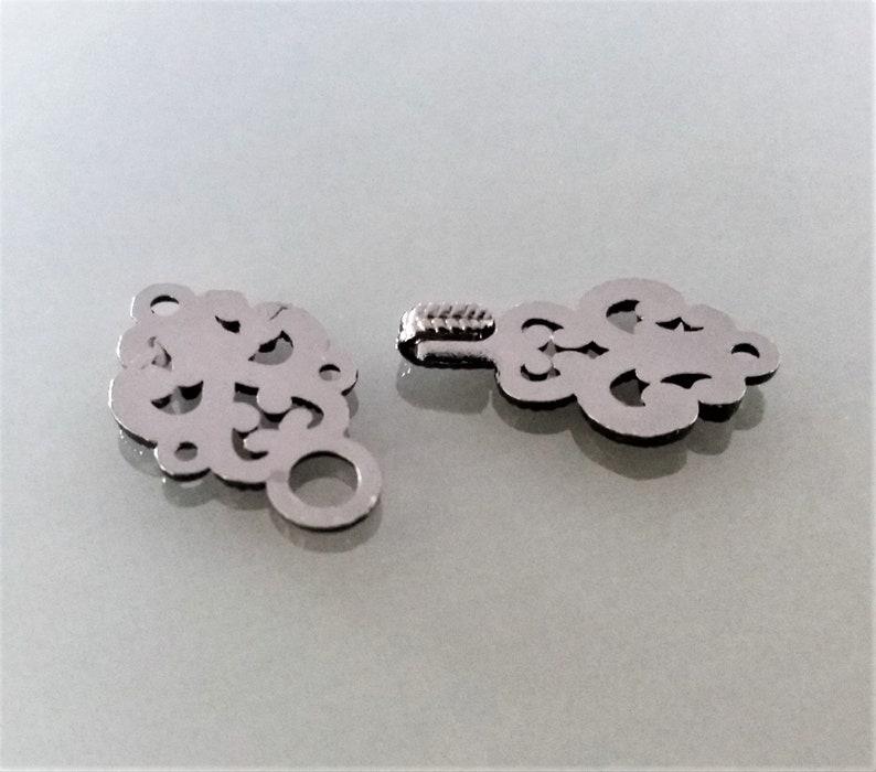 2 sewing hooks metal color gun barrel