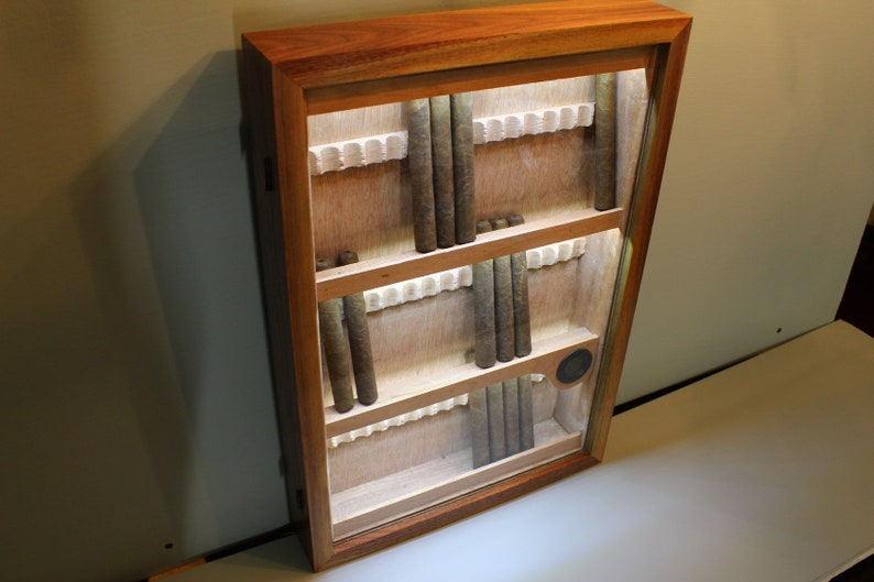 Wall display humidor available in exotic and domestic hardwoods  LED  illumination included