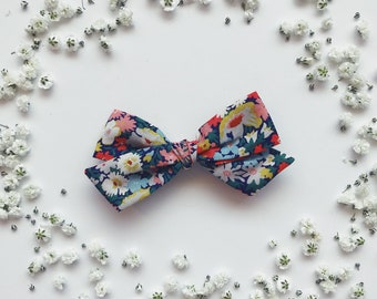 7f9e69fa02 Thorpe Liberty of London floral bow kids baby toddler on nylon headband or  hair clip flowers Navy blue red yellow green white fall winter