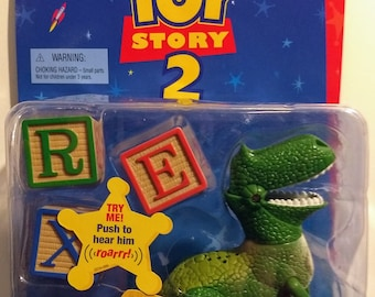 Disney Pixar Toy Story 2 Wreck A Saurus w/Whipping Tail Movable Arms Legs! Authentic Vintage 1999! Wreck A Saurus Roars! Tail Moves!Unopened