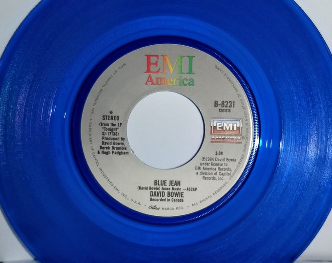 "Featured listing image: David Bowie, 7"" Vinyl Record, Blue Translucent! Authentic Vintage 1984! David Bowie,""Blue Jean' / ""Dancing With The Boys""! Near Mint Vinyl"