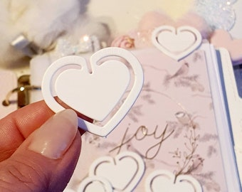 White cute heart shaped paperclip