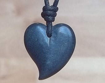 heart pendant. It's made from Indian soapstone called green granite. The size approxmatly 1.5cm. The colour is dark greenish gray.