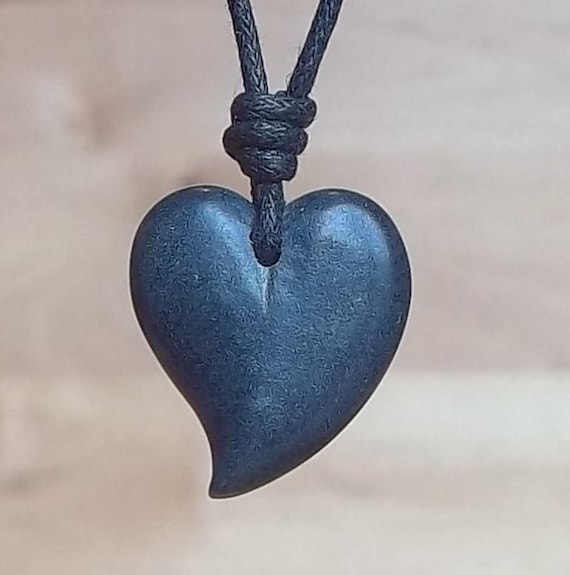 Vintage Natural Granite Stone Handcarved into a Heart pendant...it has traveled the world!