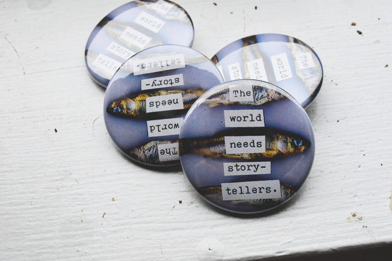 The World Needs Story-Tellers / 1.5 Inch Pin Back Button image 0