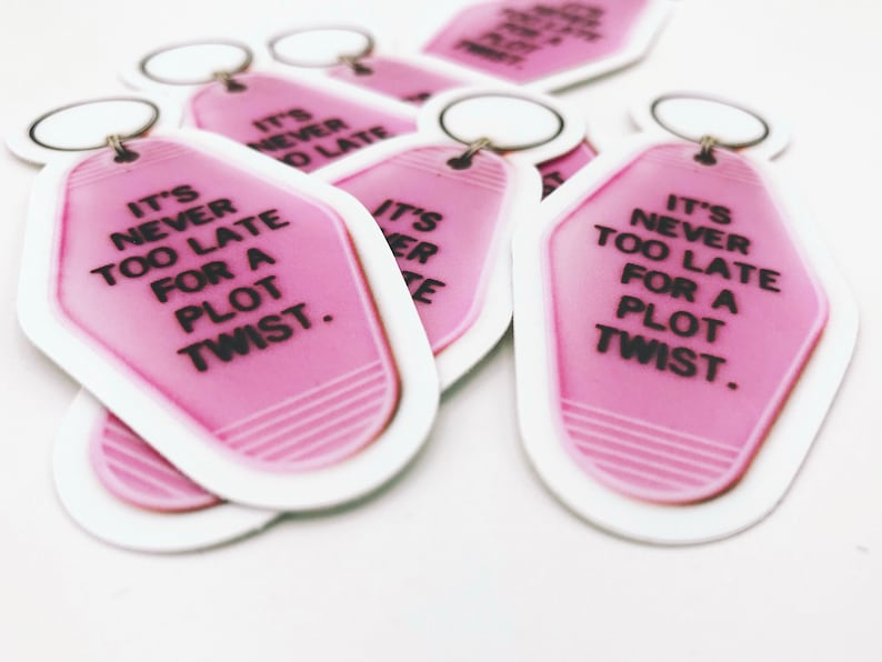 It's Never Too Late For A Plot Twist Pink Key Tag Vinyl image 0