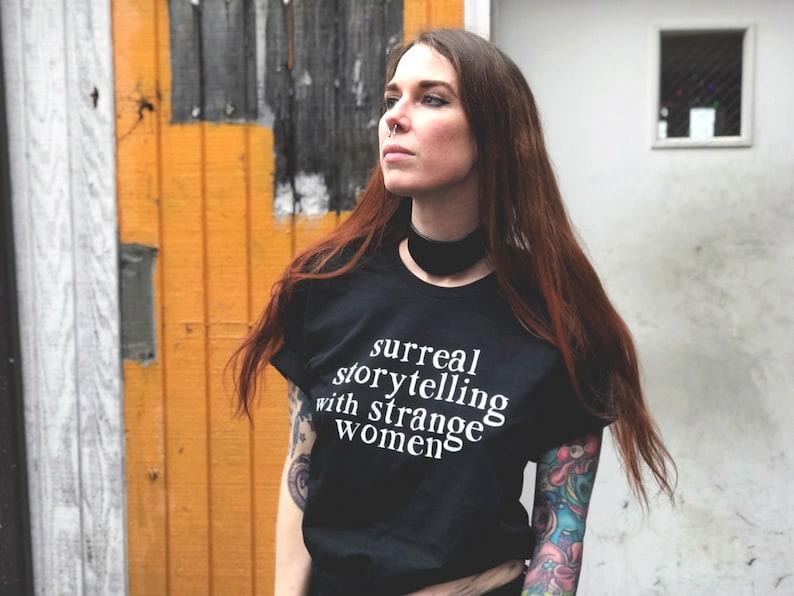 Surreal Storytelling with Strange Women Unisex T-Shirt image 0