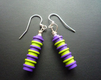 Multicoloured dangle earrings made from 6 round Lego® pieces. Finished with small pearlesque bead and silver plated hook