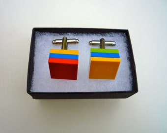 Cufflinks made using Lego® bricks: yellow, red, green and blue
