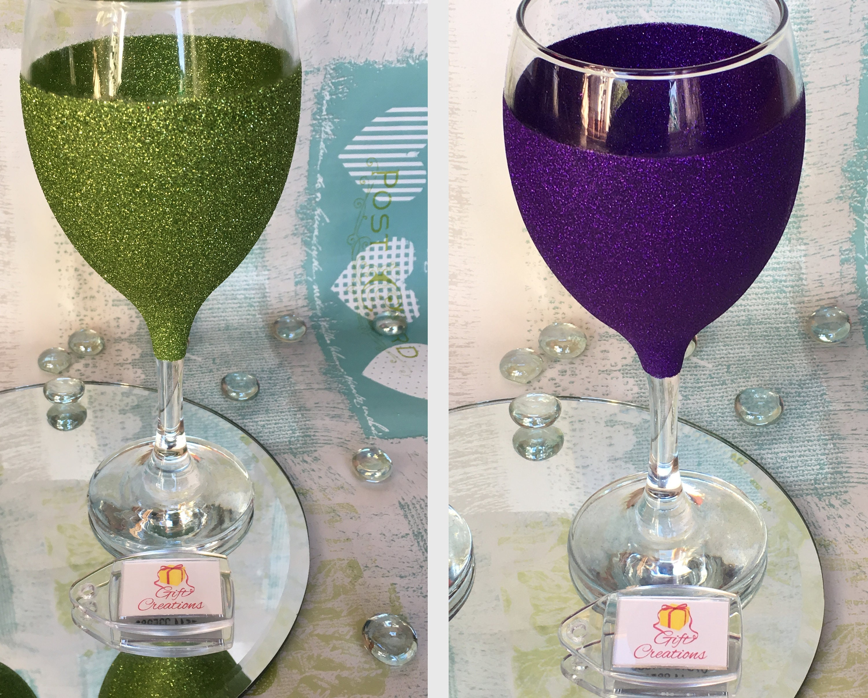 sold individually Green and dark purple stemless wine glasses