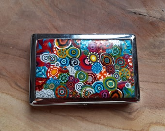 Cigarette case or metal business card and red/multicolored polymer paste
