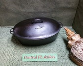 Wagner Ware 5 Stylized Logo Cast Iron Oval Roaster With Drip Drop Oval Lid And Aluminum Trivet Circa 1920s Vintage