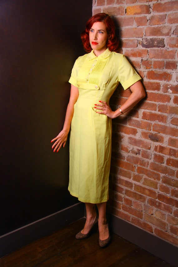 1950s yellow wiggle dress with pockets